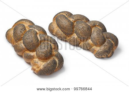 Whole fresh Challah breads with poppy seeds on white background
