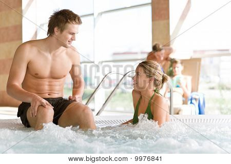 Swimming Pool - Young Couple Relax In Hot Tub