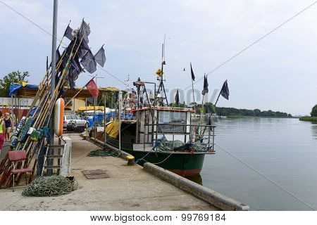 DZIWNOW - AUGUST 16: Fishing boats at the pier on 16 August 2015 in Dziwnow, Poland.