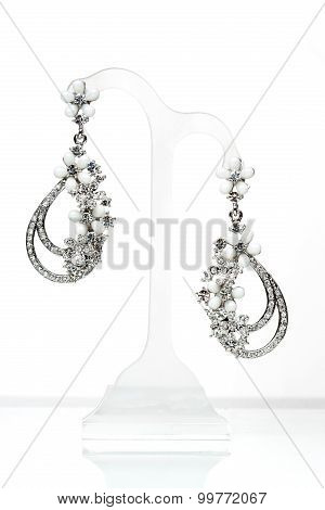 earrings with Briliant on the white