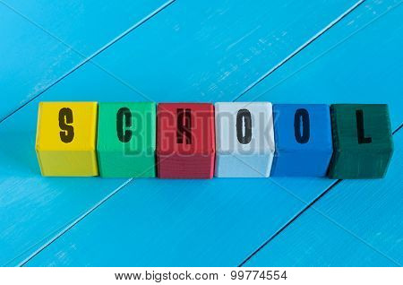 Word School on children's colourful cubes or blocks - educational background for teaching.