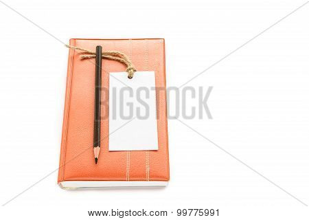 Notebook,pencil And White Card On White Background