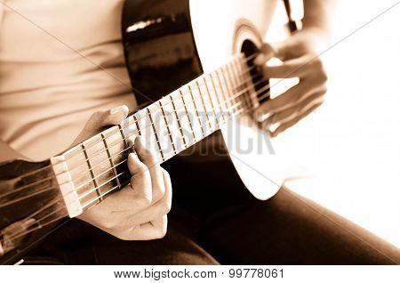 Girl Playing Guitar,hand Focus Sepia Tone.