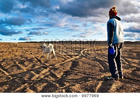 The Woman Plays With A Dog In The Fall On The Nature
