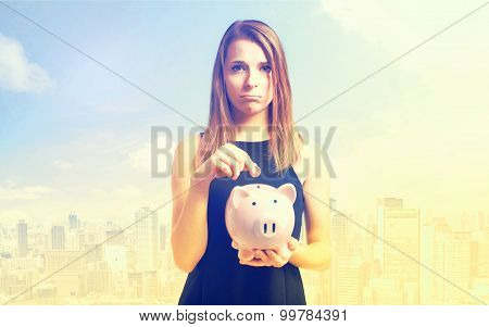 Unhappy Young Woman With Pink Piggy Bank
