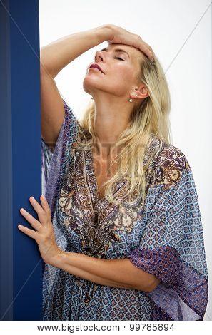 Portrait Of Blond Woman In Blue Dress