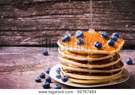 Pancakes with blueberries & honey