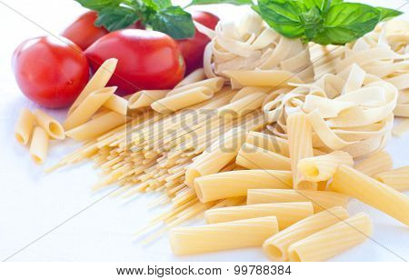 Pasta of various sizes with tomato and basil