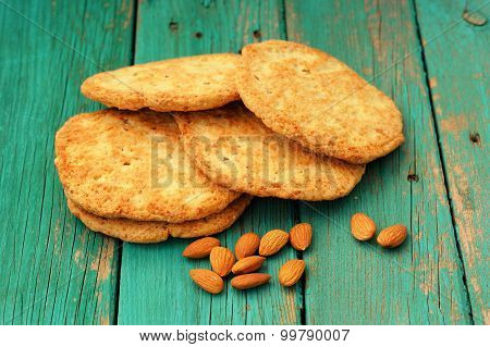 Yummy Homemade Almond Cookies With Whole Almonds On Turquoise Shabby Background