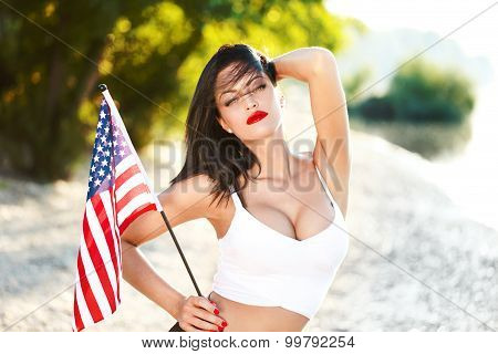 Sexy Brunette Woman Holding Usa Flag Outdoor