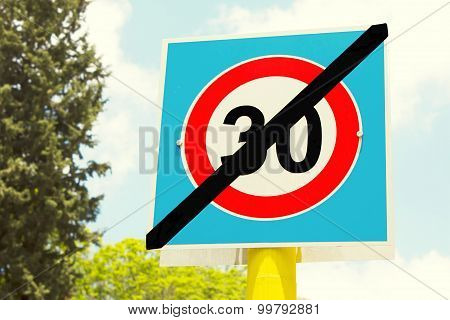 road sign 30 zone ends here