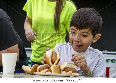 Grabbing A Hot Dog.