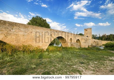 Scenic view of an ancient stone medieval bridge at dusk in Frias Castilla y Leon Spain.
