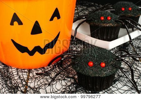 Halloween spider cupcakes with jack o lantern candy pail