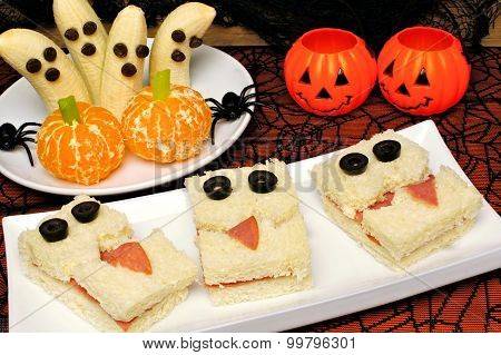 Healthy Halloween monster sandwiches, banana ghosts and orange pumpkins