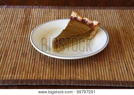 Single Slice Of Homemade Pumpkin Pie On Plate