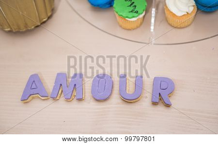 Wedding decor, AMOUR letters on table. AMOUR decoration on festive table