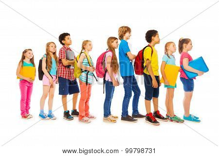 School kids with backpacks and textbooks