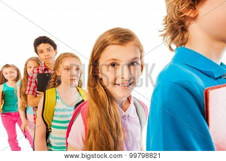 Girl in the line smiling among other students