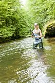 picture of fisherwomen  - young woman fishing in river at summer day - JPG