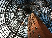 stock photo of shopping center  - brick tower that dominates the shopping centre at melbourne central in australia - JPG