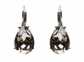 stock photo of lapis lazuli  - earrings with black stones on the white background - JPG