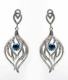image of lapis lazuli  - earrings with blue stones on the white background - JPG