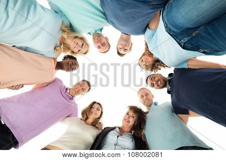 Portrait Of Creative Business People Standing In Huddle
