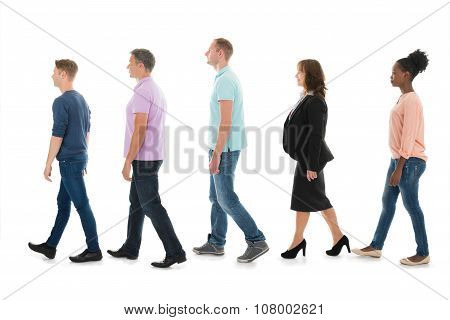 Creative Business People Walking With Manager In Row