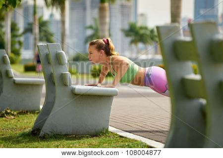 Woman Training Pectorals Doing Pushups On Street Bench-3