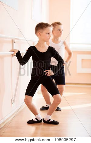 Young boys working at the barre.