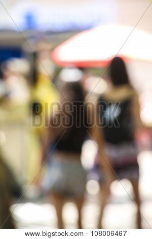 Defocused Wiew Of Women Walking In The Street In Summer