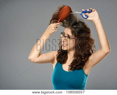 Woman Doing Haircut With Scissors