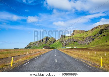 Straight asphalt road in the South coast of Iceland