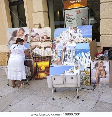Local Woman Offers Paintings To Tourists