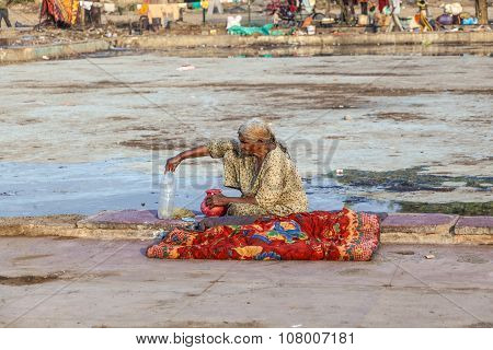 Poor Woman Rests With A Bottle Of Water At Empty  Meena Bazaa