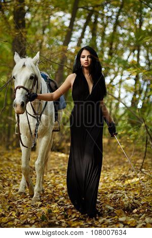 Woman With Horse In The Forest