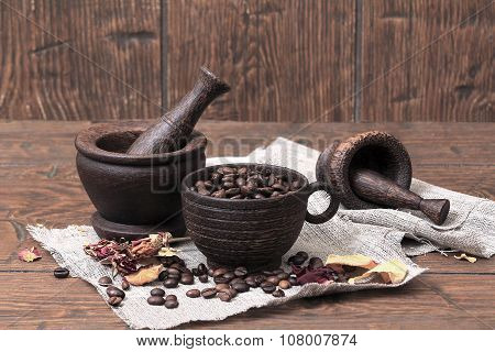 Two Old Mortars With Pestles And A Cup With Coffee Beans Is Lying On Vintage  Homespun Canvas