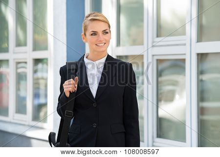 Businesswoman Carrying Briefcase While Looking Away