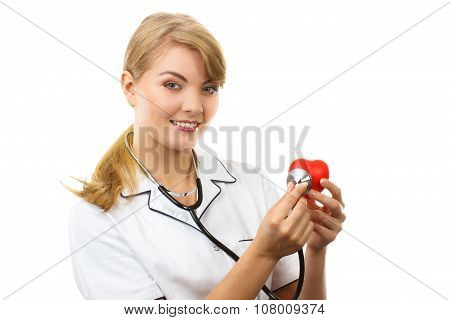 Woman Doctor With Stethoscope Examining Red Heart, Healthcare Concept