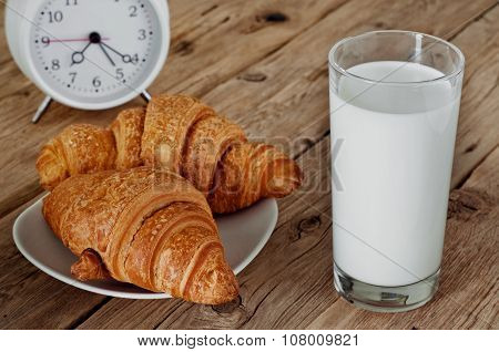 Morning Breakfast Of Milk And Croissant On A Wooden Table