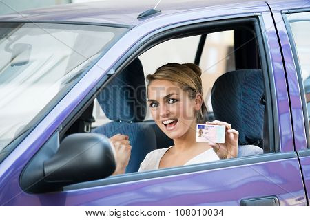 Woman Showing License While Sitting In Car