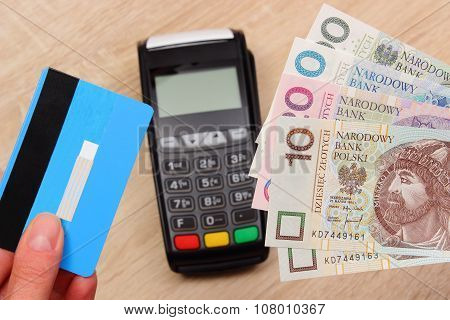 Polish Currency Money And Credit Card With Payment Terminal In Background, Finance Concept
