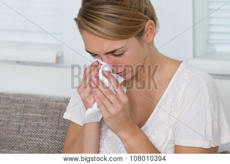 Woman Using Tissue While Suffering From Cold