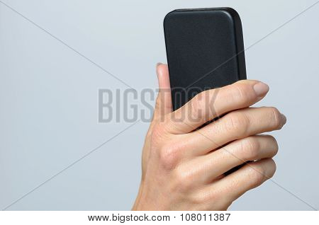 Hand Holding A Black Cellular