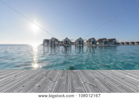 Wood Table Infron Of Water Bungalow Resort