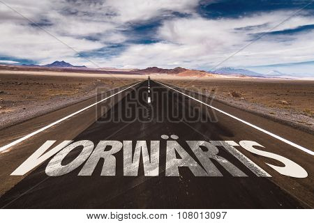 Forward (In German) written on desert road