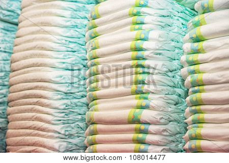 Children's Diapers Stacked In A Piles In The Child Room