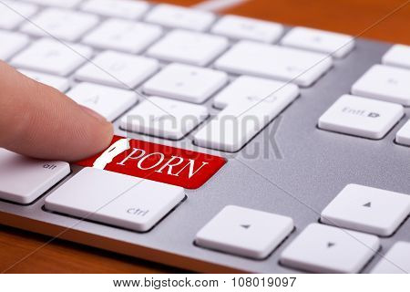 Finger Pressing On Red Button With Porn Word And Naked Woman Silhuette On It