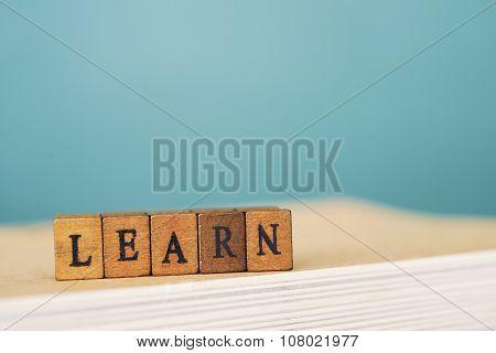 LEARN word written on wood block  background